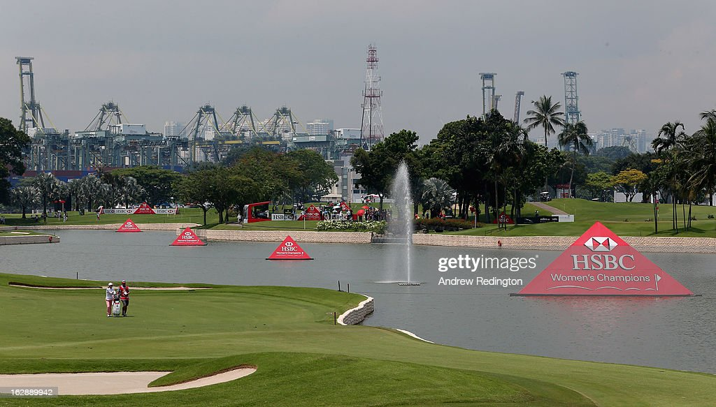 Na Yeon Choi of South Korea waits with her caddie on the 18th hole during the second round of the HSBC Women's Champions at the Sentosa Golf Club on March 1, 2013 in Singapore, Singapore.