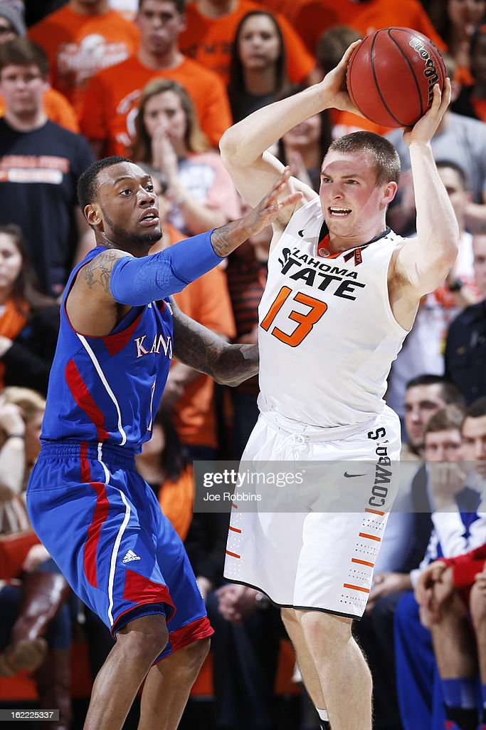 Naadir Tharpe #1 of the Kansas Jayhawks defends against Phil Forte #13 of the Oklahoma State Cowboys during the game at Gallagher-Iba Arena on February 20, 2013 in Stillwater, Oklahoma. Kansas won 68-67 in two overtimes.