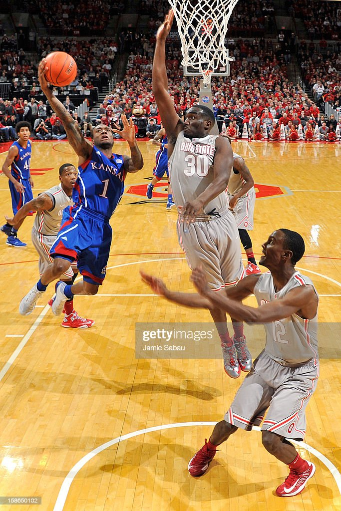 Naadir Tharpe #1 of the Kansas Jayhawks drives to the basket in the second half as Evan Ravenel #30 of the Ohio State Buckeyes defends on December 22, 2012 at Value City Arena in Columbus, Ohio. Kansas defeated Ohio State 74-66.