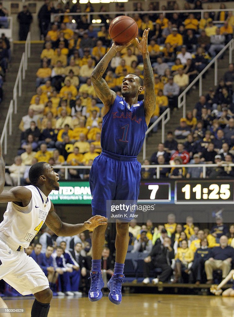 Naadir Tharpe #1 of the Kansas Jayhawks pulls up for a three against the West Virginia Mountaineers at the WVU Coliseum on January 28, 2013 in Morgantown, West Virginia.