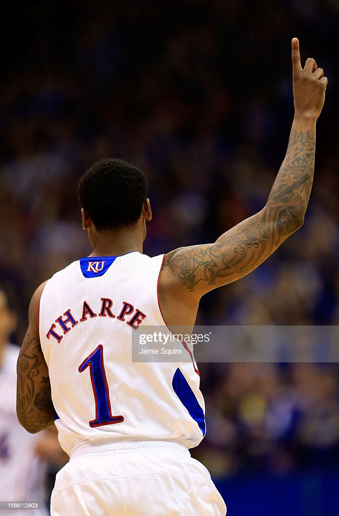Naadir Tharpe #1 of the Kansas Jayhawks reacts after scoring during the game against the Baylor Bears at Allen Fieldhouse on January 14, 2013 in Lawrence, Kansas.