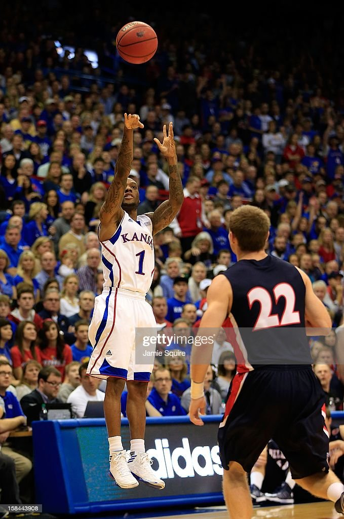 Naadir Tharpe #1 of the Kansas Jayhawks shoots a jumpshot over Reece Chamberlain #22 of the Belmont Bruins during the game at Allen Fieldhouse on December 15, 2012 in Lawrence, Kansas.