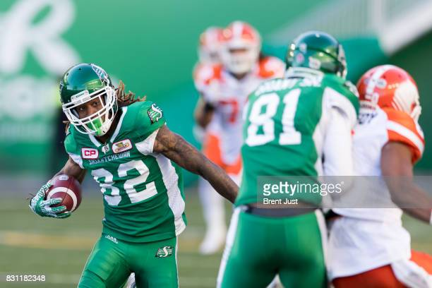 Naaman Roosevelt of the Saskatchewan Roughriders looks for a block while running with the ball after a catch in the game between the BC Lions and the...