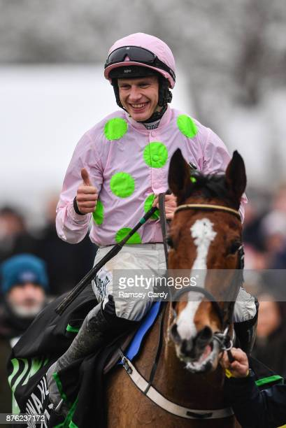 Naas Ireland 19 November 2017 Jockey Paul Townend celebrates after winning the Morgiana hurdle on Faugheen at Punchestown Racecourse in Naas Co...