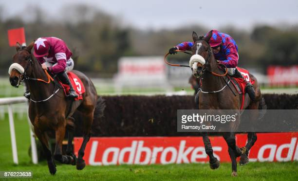 Naas Ireland 19 November 2017 Jury Duty with Robbie Power up leads Shattered Love with Sean Flanagan up over the last on their way to winning the...