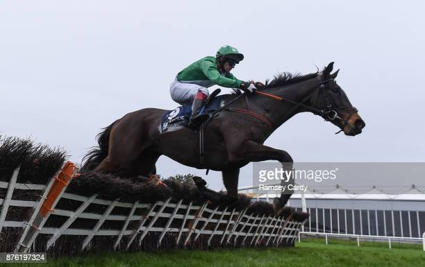Naas Ireland 19 November 2017 Mtada Supreme with Benny Walsh up jumps the last on their way to winning the steeplechase race at Punchestown...