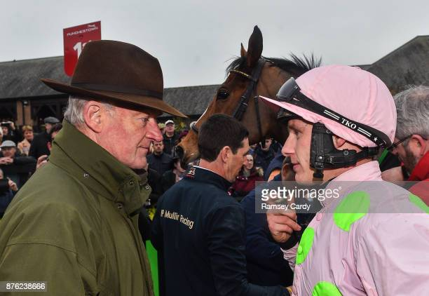 Naas Ireland 19 November 2017 Trainer Willie Mullins in conversation with jockey Paul Townend after sending out Faugheen to win the Morgiana hurdle...