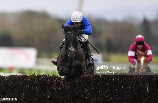Naas Ireland 19 November 2017 Woodland Opera with Robbie Power up jumps the last on their way to winning the novice steeplechase at Punchestown...