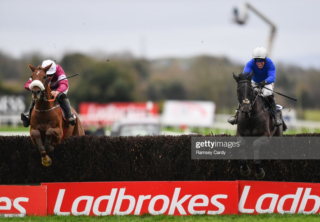 Naas , Ireland - 19 November 2017; Woodland Opera, with Robbie Power up, right, leads Tombstone, with Davy Russell up, over the last on their way to winning the novice steeplechase at Punchestown Racecourse in Naas, Co Kildare.