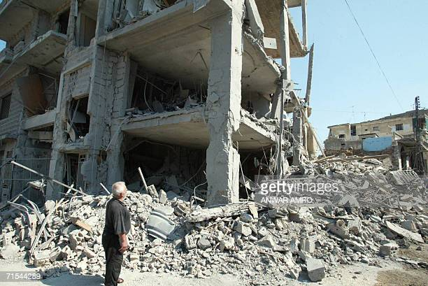 A looks at a destroyed building in the southern Lebanese town of Nabatiyeh 31 July 2006 as Israel announced a 48hour suspension of air strikes...