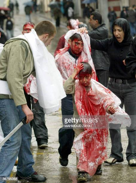 Lebanese Shiites boys flagellate themselves during a ceremony marking Ashura in the southern Lebanese city of Nabatiyeh 09 January 2006 Ashura is the...