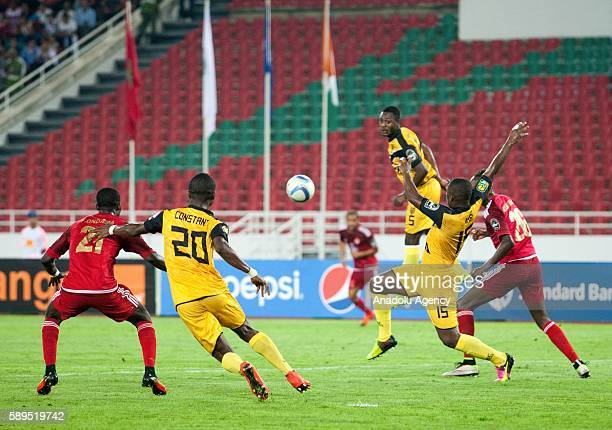 Nabi Ibrahim Kone and Koffi Constant Kouame of ASEC in action against Abdeladim Khadrouf and Fabrice Ondama of Wydad Casablanca during the Group A...