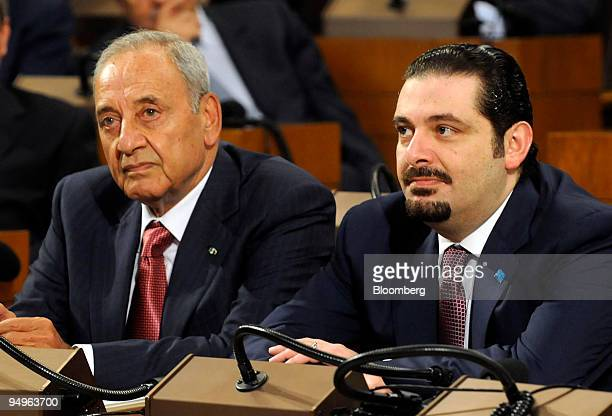 Nabih Berri the parliament speaker left sits with Saad Hariri a candidate for prime minister during a session of the Lebanese parliament in Beirut...