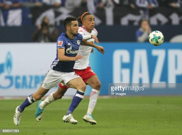 Nabil Bentaleb and Yussuf Yurary Poulsen of Leipzig battle for the ball during the Bundesliga match between FC Schalke 04 and RB Leipzig at...