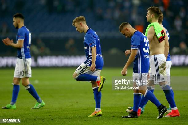 Nabil Bentaleb Max Meyer and Donis Avdijaj of Schalke walk off the pitch dejected after quit the quarter final winning 32 the UEFA Europa League...