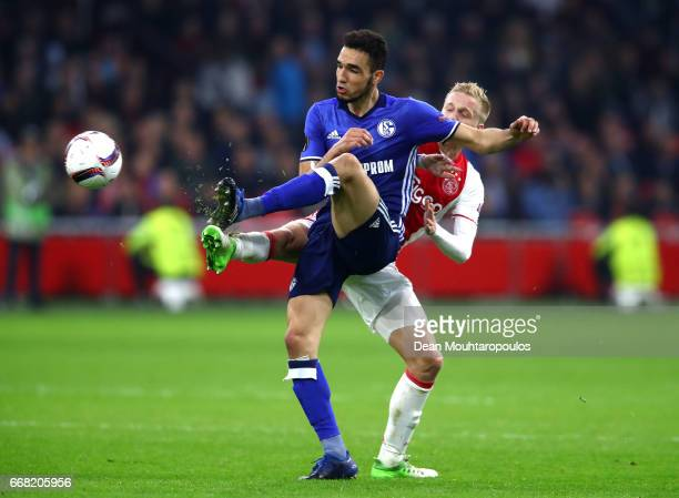 Nabil Bentaleb of FC Schalke 04 controlls the ball under pressure from Donny van de Beek of Ajax during the UEFA Europa League quarter final first...