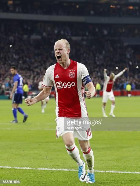 Nabil Bentaleb of FC Schalke 04 Davy Klaassen of Ajax Hakim Ziyech of Ajaxduring the UEFA Europa League quarter final match between Ajax Amsterdam...