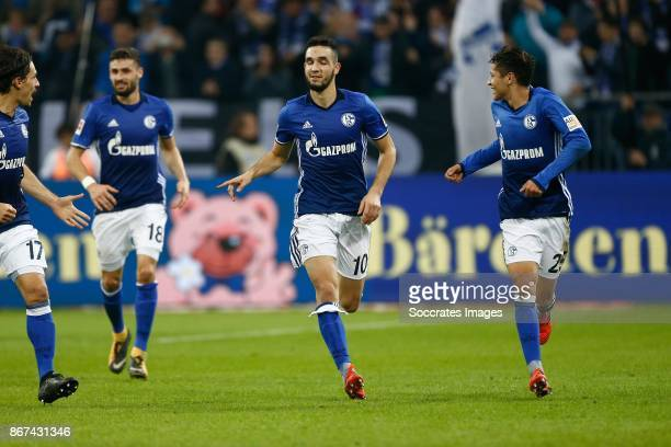 Nabil Bentaleb of Schalke 04 celebrates 10 with Benjamin Stambouli of Schalke 04 and Amine Harit of Schalke 04 during the German Bundesliga match...