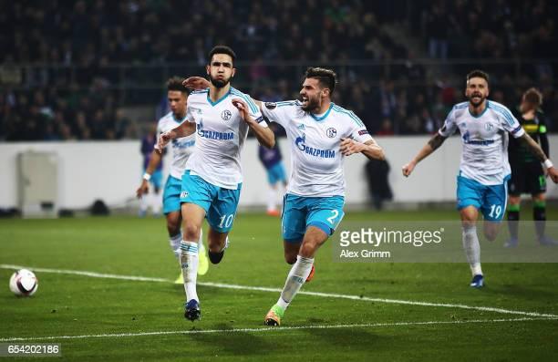 Nabil Bentaleb of Schalke 04 celebrates with Daniel Caligiuri of Schalke 04 after scoring a penalty goal during the UEFA Europa League Round of 16...