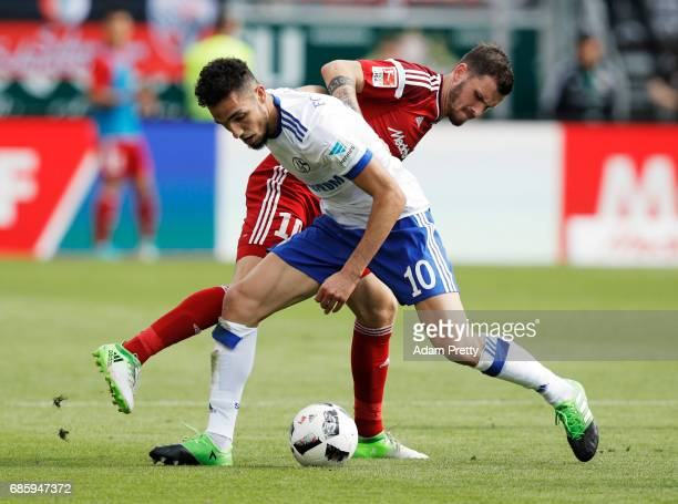 Nabil Bentaleb of Schalke 04 is challenged by Pascal Gross of Ingolstadt 04 during the Bundesliga match between FC Ingolstadt 04 and FC Schalke 04 at...