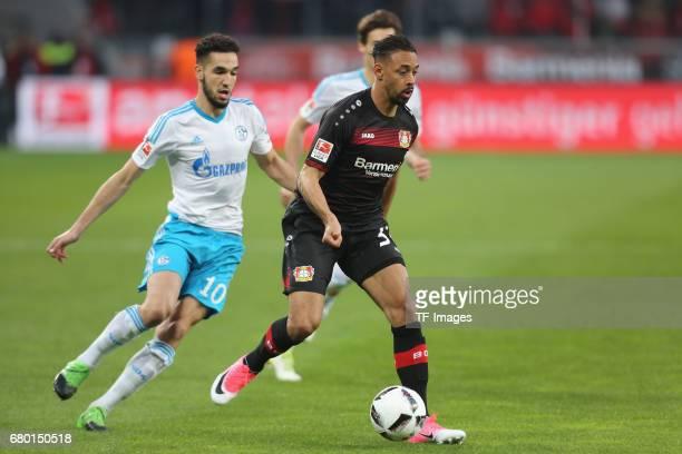 Nabil Bentaleb of Schalke and Karim Bellarabi of Leverkusen battle for the ball during to the Bundesliga match between Bayer 04 Leverkusen and FC...