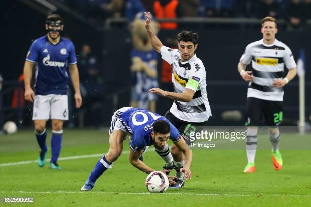 Nabil Bentaleb of Schalke and Lars Stindl of Borussia Moenchengladbach battle for the ball during the UEFA Europa League Round of 16 first leg match...