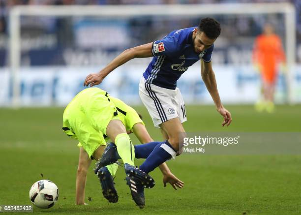 Nabil Bentaleb of Schalke battles for the ball with Dominik Kohr of Augsburg during the Bundesliga match between FC Schalke 04 and FC Augsburg at...