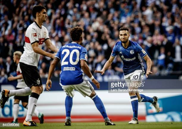 Nabil Bentaleb of Schalke celebrates with team mates after scoring his teams first goal during the Bundesliga match between FC Schalke 04 and VfB...