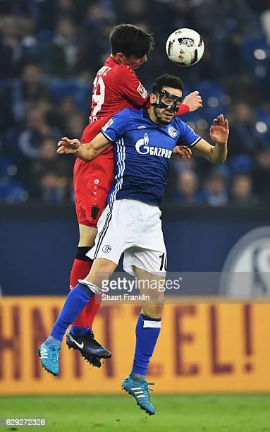 Nabil Bentaleb of Schalke is challenged by Kai Havertz of Leverkusen during the Bundesliga match between FC Schalke 04 and Bayer 04 Leverkusen at...
