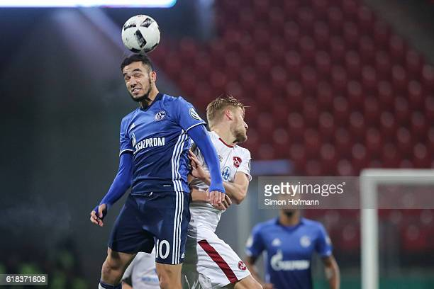 Nabil Bentaleb of Schalke jumps for a header with Hanno Behrens of Nuernberg during the DFB Cup match between 1 FC Nuernberg and FC Schalke 04 at...