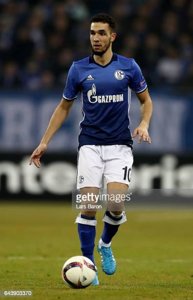 Nabil Bentaleb of Schalke runs with the ball during the UEFA Europa League Round of 32 second leg match between FC Schalke 04 and PAOK Saloniki at...