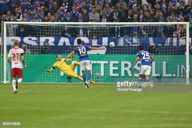 Nabil Bentaleb of Schalke scores from the penalty spot against Peter Gulacsi of Leipzig to make it 10 during the Bundesliga match between FC Schalke...