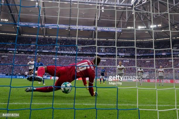 Nabil Bentaleb of Schalke scores from the penalty spot over RonRobert Zieler goalkeeper of Stuttgart to make it 10 during the Bundesliga match...