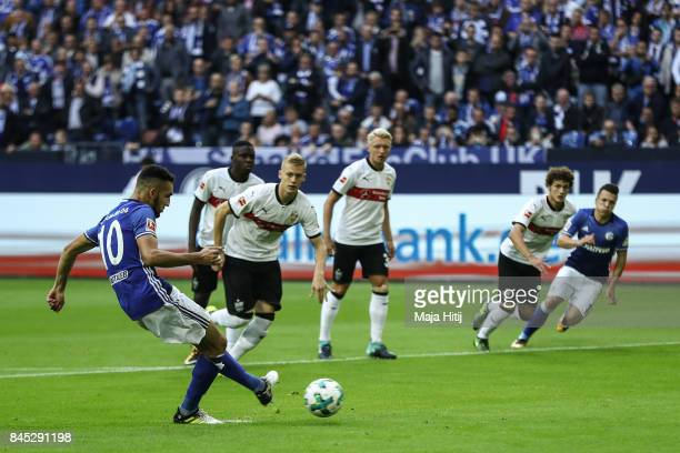 Nabil Bentaleb of Schalke scores from the penalty spot to make it 10 during the Bundesliga match between FC Schalke 04 and VfB Stuttgart at...
