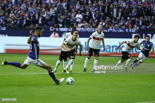 Nabil Bentaleb of Schalke scores from the penalty spot to make it 10 during the Bundesliga match between FC Schalke 04 and VfB Stuttgart at...