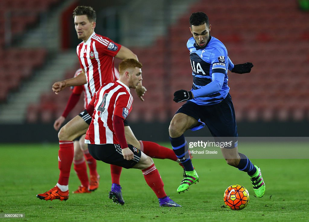 <a gi-track='captionPersonalityLinkClicked' href=/galleries/search?phrase=Nabil+Bentaleb&family=editorial&specificpeople=9549300 ng-click='$event.stopPropagation()'>Nabil Bentaleb</a> (R) of Tottenham Hotspur U21 skips past the challenge of Harry Reed (L) of Southampton U21 during the Barclays U21 Premier League match between Southampton and Tottenham Hotspur at St Mary's Stadium on February 9, 2016 in Southampton, England.