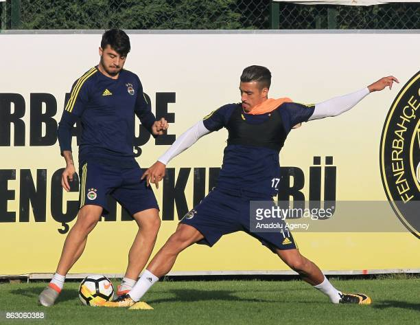 Nabil Dirar and Ozan Tufan of Fenerbahce attend a training session prior to the Turkish Super Lig match between Galatasaray and Fenerbahce at...