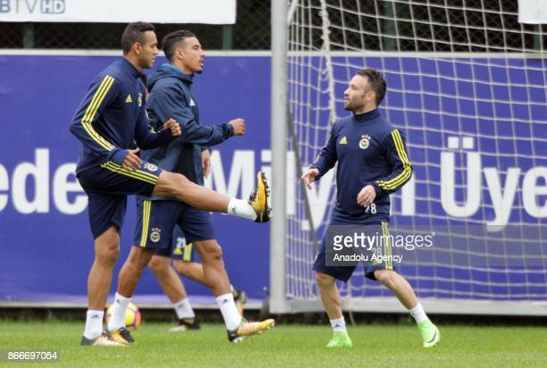 Nabil Dirar Matthieu Valbuena and Josef de Souza of Fenerbahce attend a training session prior to the Turkish Super Lig match between Fenerbahce and...