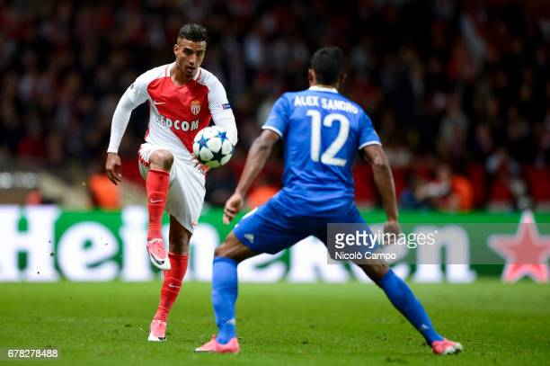 Nabil Dirar of AS Monaco competes with Alex Sandro of Juventus FC during the UEFA Champions League Semi Final first leg football match between AS...