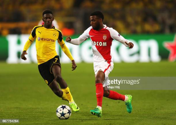 Nabil Dirar of AS Monaco holds off pressure from Gonzalo Castro of Borussia Dortmund during the UEFA Champions League Quarter Final first leg match...