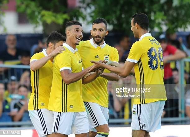 Nabil Dirar of Fenerbahce celebrates after scoring a goal with Mehmet Topal and Josef De Souza of Fenerbahce during a practice match between...