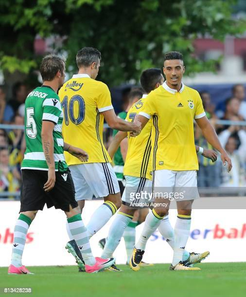 Nabil Dirar of Fenerbahce celebrates after scoring a goal with Robin Van Persie of Fenerbahce during a practice match between Fenerbahce and Sporting...