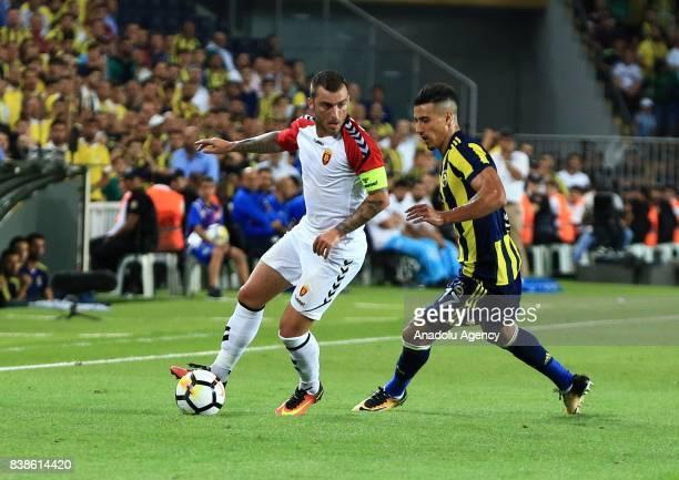 Nabil Dirar of Fenerbahce in action against Dejan Blazevski of Vardar during a UEFA Europa League playoff soccer match between Fenerbahce and Vardar...