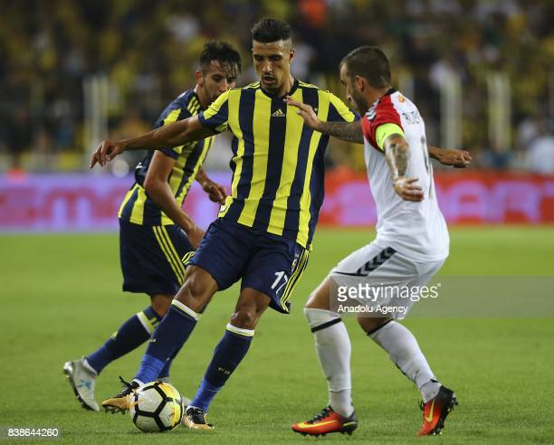 Nabil Dirar of Fenerbahce in action against Dejan Blazevski of Vardar during the UEFA Europa League playoff soccer match between Fenerbahce and...