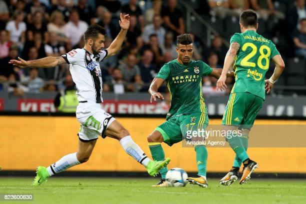 Nabil Dirar of Fenerbahce in action against Lykogiannis of Sturm Graz during the UEFA Europa League third qualifying round match between Sturm Graz...