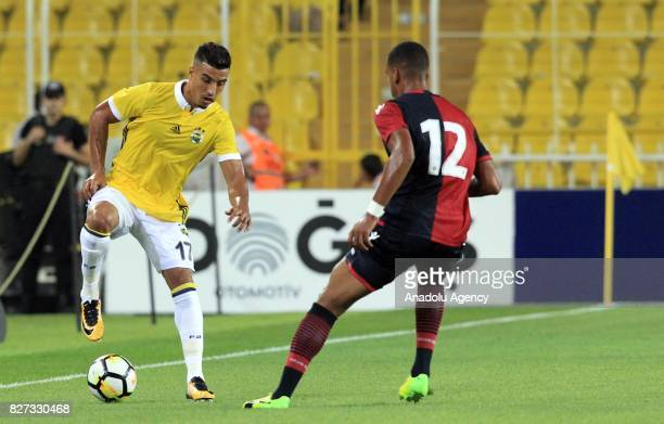 Nabil Dirar of Fenerbahce vies for the ball against Miangue Senna of Cagliari during the Friendly match between Fenerbahce and Cagliari at the Ulker...