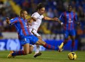 Nabil El Zhar of Levante competes for the ball with Manuel Iturra of Granada during the La Liga match between Levante UD and Granada CF at Ciutat de...