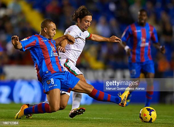 Nabil El Zhar of Levante competes for the ball with Manuel Iturra of Granada during the La Liga match between Levante UD and Granada CF at Ciutat de...