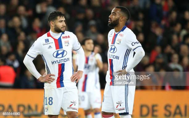 Nabil Fekir and Alexandre Lacazette of Lyon look on after PSG first goal during the French Ligue 1 match between Paris SaintGermain and Olympique...