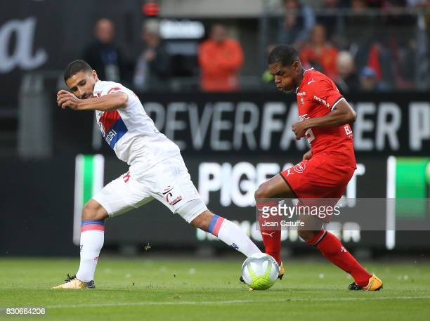 Nabil Fekir of Lyon and Benjamin Bourigeaud of Stade Rennais during the French Ligue 1 match between Stade Rennais and Olympique Lyonnais at Roazhon...